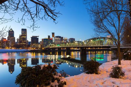 eastbank: Portland Oregon downtown snow on the banks of Willamette River winter night scene Stock Photo