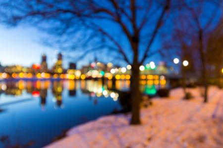 eastbank: Portland Oregon downtown skyline along Willamette River during winter blue hour blurred defocused bokeh