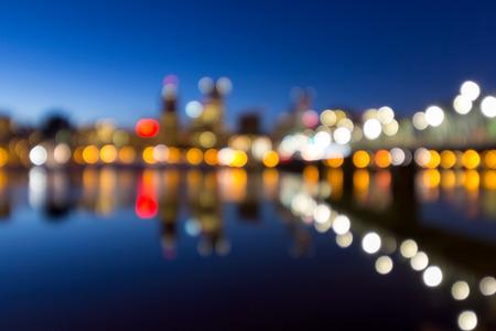 willamette: Portland Oregon downtown skyline along Willamette River during blue hour blurred defocused bokeh