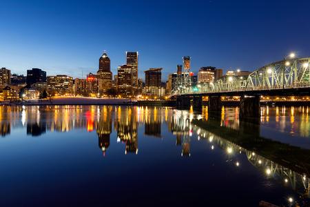eastbank: Portland Oregon downtown skyline along Willamette River during blue hour winter night scene