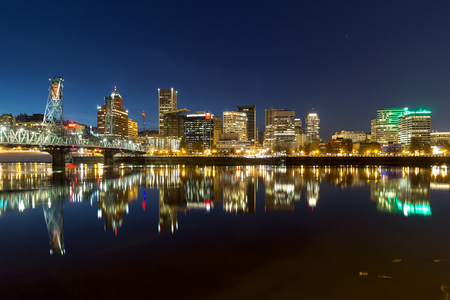 eastbank: Portland Oregon downtown city skyline reflection on Willamette River during evening blue hour