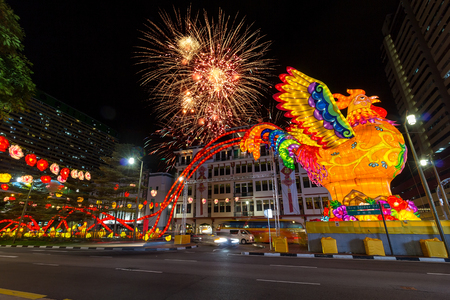 holiday tradition: Singapore Chinatown 2017 Lunar Chinese New Year Celebration with Fireworks and Year of the Rooster Decoration Stock Photo