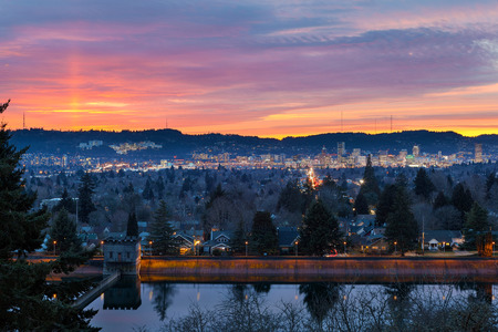 Colorful sunset over Mt Tabor City Park Reservior and the skyline of Portland Oregon downtown