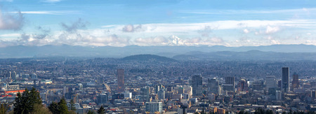 Portland Oregon downtown cityscape with Mt Hood on a beautiful sunny day scenic view panorama
