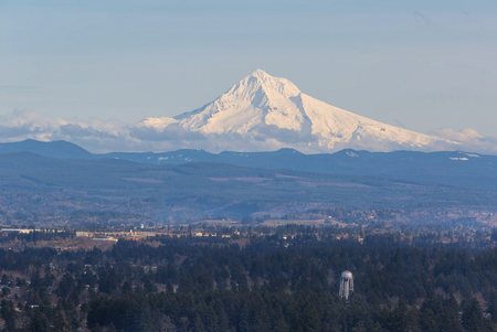 mount hood: Snow covered Mount Hood view with water tower in the landscape on a sunny day