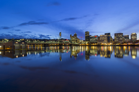 eastbank: Portland Oregon downtown city skyline by Hawthorne Bridge over Willamette River waterfront during evening blue hour Stock Photo