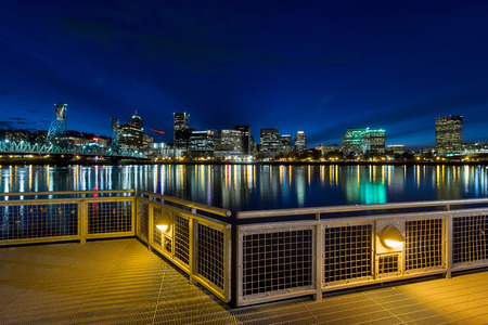 eastbank: Portland Oregon downtown city skyline from Eastbank Esplanade along Willamette River waterfront during blue hour