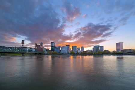 Sunset over sklyine of Portland Oregon by Hawthorne Bridge along Willamette River