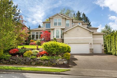 frontyard: House with green lawn manicured frontyard garden in suburban residential neighborhood on a sunny day