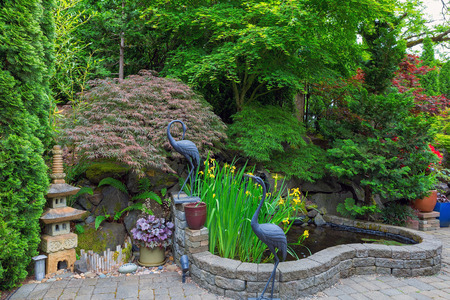 hinoki: Home Garden Backyard with lush plants Japanese landscaping pond stone pagoda bronze cranes and paver brick patio