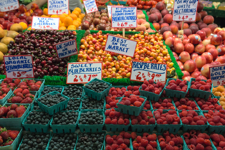 pike place: Fresh fruits Nectarines Cherry Strawberry Blueberry Rashberry Apricot in public market fruit stall