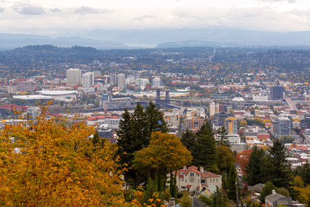Northwest and Northeast Portland Oregon cityscape and bridges over Willamette River in Fall Season Stock Photo
