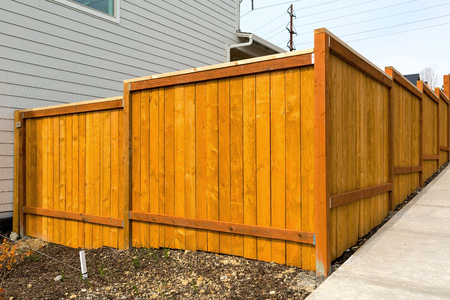 New home backyard wood fence construction