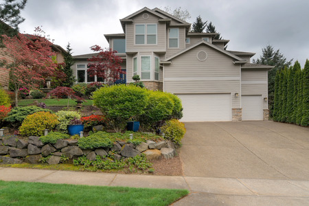 Single family home in North American suburban neighborhood with front yard garden landscaping in spring season