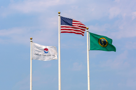 USA Port of Vancouver State of Washington Flags against blue sky background Stock Photo