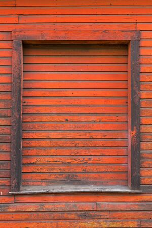 Old red storage warehouse barn door wood exterior siding grunge texture background Stock Photo