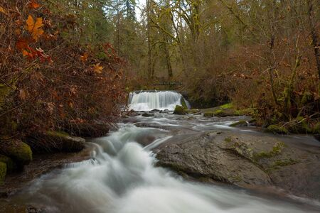 Bridge over McDowell Creek Falls in Oregon County Park during winter Stock Photo