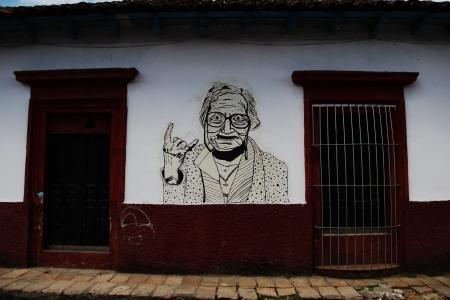 Street art of a grandma showing a rock gesture Stock fotó