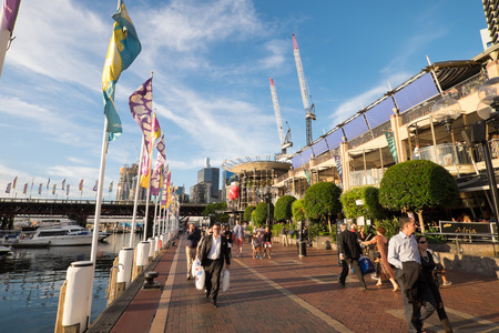 SYDNEY AUSTRALIA  MARCH 14 2015: Darling Harbour in the heart of Sydney business central district offers a variety of restaurants entertainment and boat cruises that gathers countless visitors.