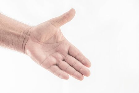 Man's hand narrowing in the form of a greeting on a white background. Space to write. Close-up Stock Photo