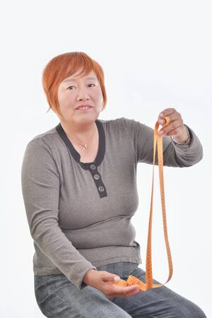A woman with a measuring tape