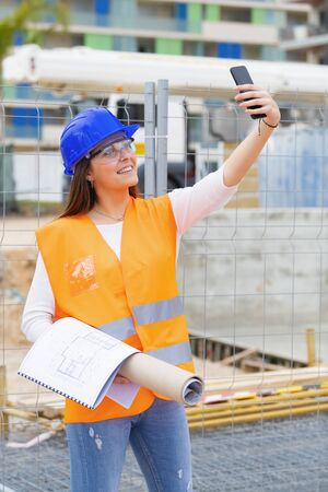 Smiling teenager with safety gear takes a photo of herself