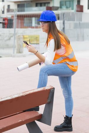 Side view of a teenage apprentice with safety gear