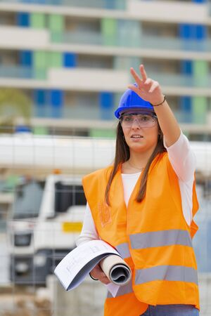 Closeup of an architecture student with a raised arm