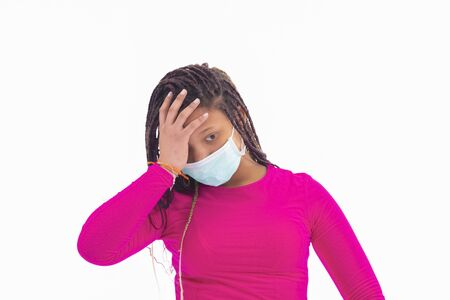 Worried girl wearing mask with hand in forehead