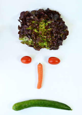 market gardener: A smiley face angry, with vegetables, salad, carrots, tomatoes.