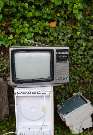 retraining: Electronic waste with vintage TV. Stock Photo