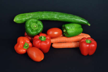 market gardener: A Assortment pepper with tomato, carrot and cucumber. Stock Photo