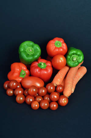 market gardener: A assortment pepper with tomato and carrot.