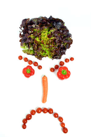 discontented: A angry smiley face, with vegetables.