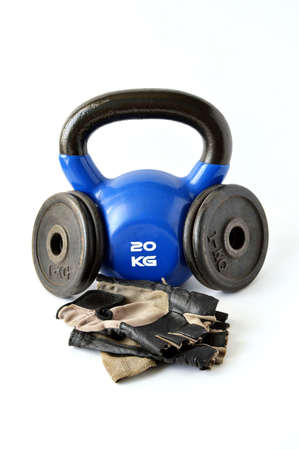 tiring: Tools for bodybuilding, fitness and crossfit. Weight, glove and kettlebell.