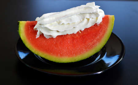 gastronome: watermelon and whipped cream. Stock Photo