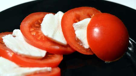 tempest: Tomato and mozzarella slices Stock Photo