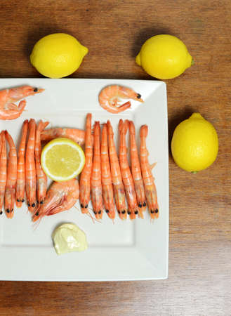 seafood platter: Seafood platter with shrimp, and lemon.