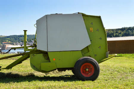 A baler type agricultural equipment, to make straw or hay bales.