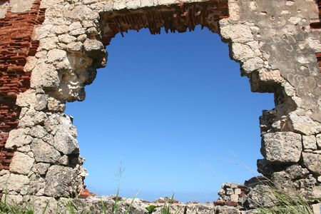 Blue Sky Through Hole in Ruin Wall in Puerto Rico photo