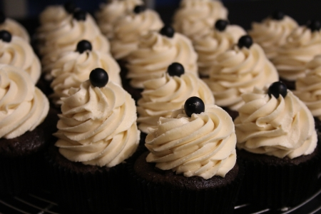 piped: Chocolate Cupcakes Closeup Stock Photo