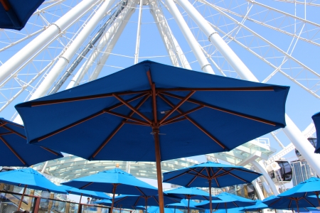 Seattle Washington Ferris Wheel and Blue Umbrellas Editorial