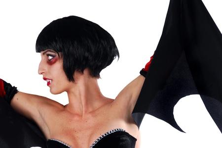 Vampire girl on a white background. photo