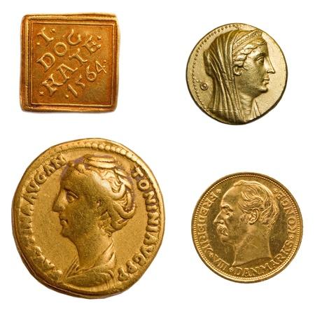 4 different genuine antique gold coins. Imagens