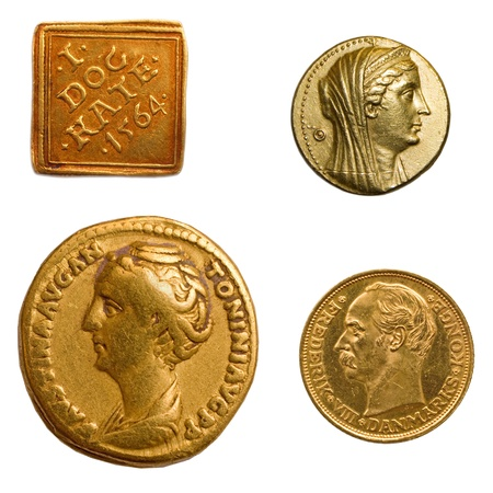 4 different genuine antique gold coins. Stock Photo