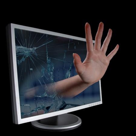 Hand coming through monitor