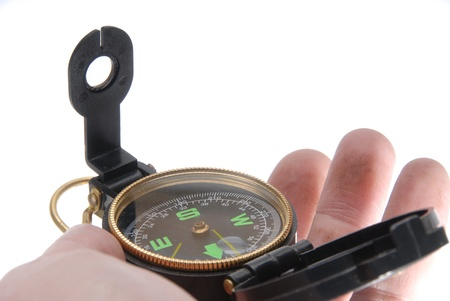 orienting: hand holding compass Stock Photo