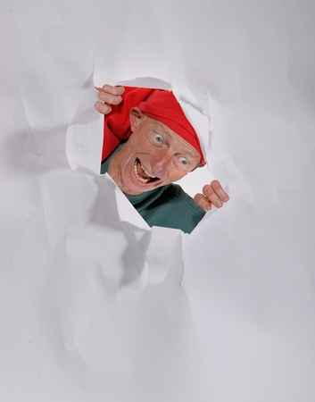 ELF coming through a hole in a piece of paper