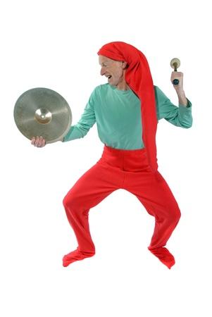 goblin: Elf hammering at a brass disk