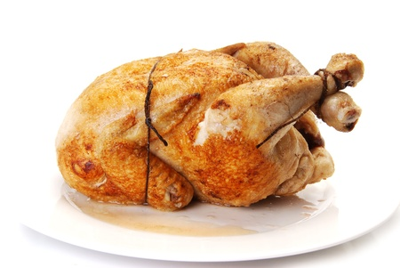 chicken grill: Whole fried Chicken on a white plate Stock Photo